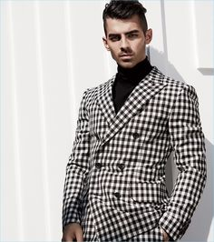 DNCE frontman Joe Jonas sports a black and white check suit with a turtleneck by Bally.