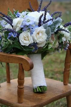 bouquet was composed of hydrangea, white garden roses, spray roses,white ranuculas, delphinium, fresh lavender, blue tweedia, and dusty miller.