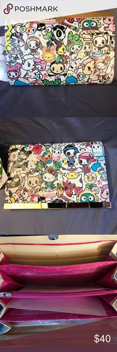 Tokidoki Sanrio Wallet NWT, ton of storage. Has a small smudge from the factory as shown in the last photo. Looks like it should come out easily with light cleaning. Has been stored in a sealed container & Comes from a smoke free home tokidoki Bags Wallets