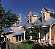 a pitched roof and gabled dormers are typical details of a new mexican territorial style - Territorial House Plans
