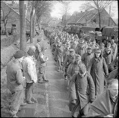 A long column of German POWs captured on the outskirts of Munster, 2 April 1945.