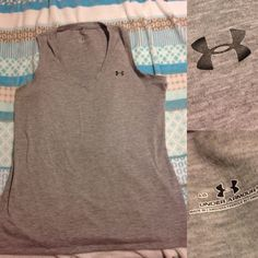 Under armor sleeveless workout top Gray Under armor sleeveless workout top! Great condition! I do same day or next day shipping based on whether you order before after 5 PM Under Armour Tops Tank Tops