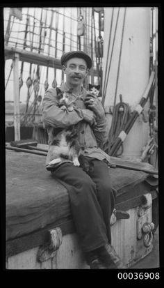 Seaman with a cat and kitten, ca. 1910. Photograph by Sam Hood. Australian Nat'l Maritime Museum. Nautical cat lover.