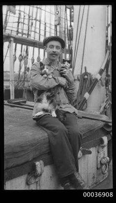 Seaman with a cat and kitten, ca. 1910. | 35 Vintage Cats At Sea