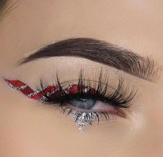 """Candy cane liner by ✨@makeupemalii✨ wearing #LuxyLash """"HOMEGIRL"""" lashes! So wispie & flirty! Love the silver glitter on the bottom! Upgrade your lash game with us today! Our luxurious lashes make the perfect gifts! Free shipping on all US orders! SHOP: www.luxy-lash.com Clickthe link in our bio now!"""