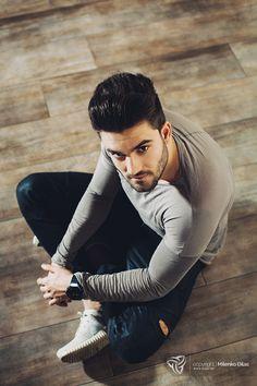 Handsome man sitting on the floor - Handsome man sitting on the floor