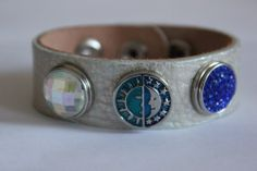 Campaign Leather bracelet with the Aurora Glass nugz button, Night/Day nugz button and Blue Crystal nugz button.  All available at www.fashionconfections.com