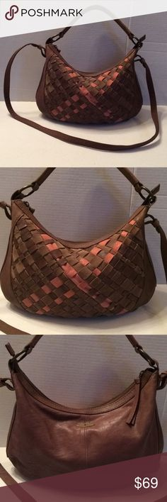 """Lucky Brand Weaved Front Leather Hobo Crossbody Beautiful Lucky Brand Crossbody Hobo. Soft brown leather with a basket brown and salmon woven front. Gold tone signature label in back. Canvas lining with one zip and two slip pockets. Zipped closure. Handle has an approx. 7"""" drop and the shoulder strap has a 22"""" drop. Phenomenal clean preowned condition. Lucky Brand Bags Crossbody Bags"""