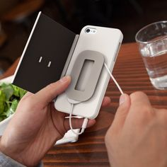 Folio, an iPhone case with integrated wallet and cord management, submitted by Ernesto Tan.