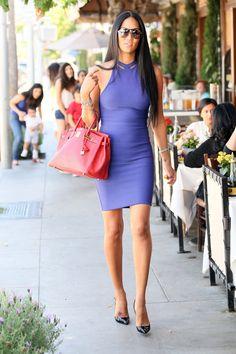 Kimora Lee Simmons and her husband purple dress red bag sunglasses long straight hair