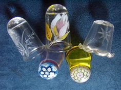 Glass Thimbles ... How unique! Never saw glass thimbles before. Gotta get myself some of these !!