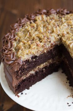 The BEST homemade German Chocolate Cake with layers of coconut pecan frosting and chocolate frosting. This cake is incredible!