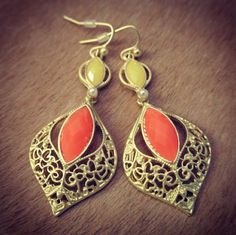 Jasmine Sunrise Earrings ($20) -Beautiful middle-eastern inspired gold earrings with tangerine and yellow tapered gemstones. A dainty pearl weaves together the two filigree layers, for a joyful burst of sunshine.