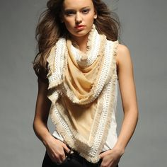 The bustling city will pause and admire your fierce fall styles, wrapped up in a gorgeous scarf.