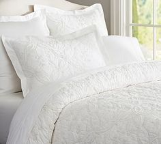 I love this Candlewick bedding to add texture to an all white bed.  Candlewick Quilt & Sham - White #potterybarn