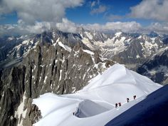 Mountaineers descending from the Aiguille du Midi, on the way to Mont Blanc