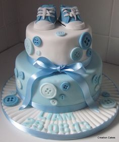 Two tier boys christening cake with handmade button trail and converse shoes!  http://www.creationcakes.org.uk