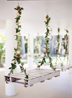 swing decorated with flowers / http://www.himisspuff.com/rustic-wood-pallet-wedding-ideas/9/