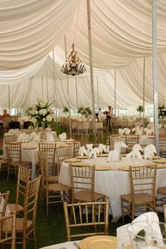 These are the chairs at Brookwood. I think I like the idea of the white ruffel table cloths that go all the way to the floor with the burlap center pieces Kim posted.