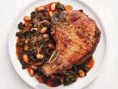 Spiced Pork Chops with Maple-Braised Greens recipe from Food Network Kitchen via Food Network