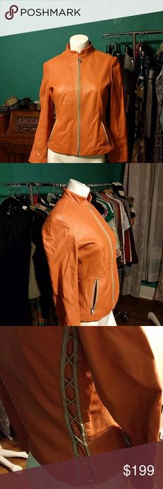 Elie Tahari Orange Leather Jacket Buttery soft Tahari leather jacket with a silky smooth satin lining. Adjustable lacing detail on the sides gives this coat a biker babe feel. Some minor wear on the bottom of the lining and three tiny (almost unnoticeable) spots of wear on the exterior. Otherwise in excellent condition. Shell is 100% leather, lining is 94% polyester and 6% elastane. Clean by leather experts only. Elie Tahari Jackets & Coats Blazers
