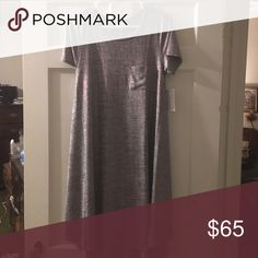 Lularoe elegant collation XS Carly NWT This stunning dress is perfect for New Year's and many occasions beyond! It's a beautiful silver with the light/faint red threading going through it LuLaRoe Dresses High Low