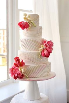 Ombre Pleated Wedding Cake with handmade sugar Tulips, Peonies and Freesia