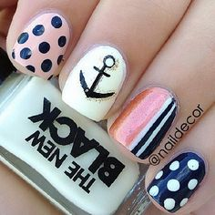 Blue pink white and yellow nautical nails with polka dots,stripes and an anchor design