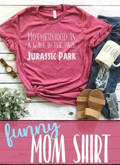 I NEED this shirt!! This mom shirt is so funny! Motherhood is a walk in the park... Jurassic Park!! This would make such a great baby shower gift - or a fun birthday or mother's day present for a mom who already has lots of littles!