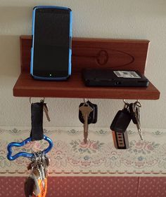 Simple and classic that looks amazing and is even utilitarian. With this stylish mahogany magnetic key holder and organizer shelf is a great way