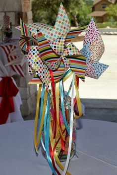 Pinwheels in mason jars, filled with tickets. Table centerpieces, decorations, at carnival/ circus themes party The ragged wren