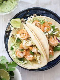 8 great recipes for frozen shrimp: Shrimp Tacos with Garlic Avocado Crema are one of our favorite kid-friendly, super fast shrimp dinner recipes Shrimp Recipes For Dinner, Fish Recipes, Seafood Recipes, Mexican Food Recipes, Great Recipes, Vegetarian Recipes, Cooking Recipes, Healthy Recipes, Healthy Tacos