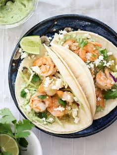 8 great recipes for frozen shrimp: Shrimp Tacos with Garlic Avocado Crema are one of our favorite kid-friendly, super fast shrimp dinner recipes | FoodieCrush