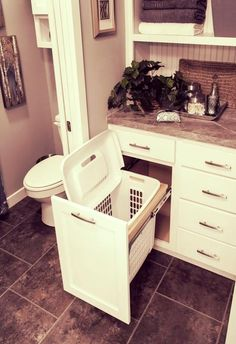 Pull-out hamper in the bathroom, clothes go straight in before a shower; great idea for the kids bathroom