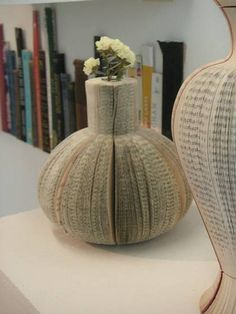 Reused books as vases. Are those book spines in the background?