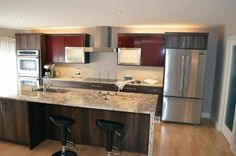 Contemporary kitchen remodel, granite countertops, island with sink, double oven, contemporary cabinets