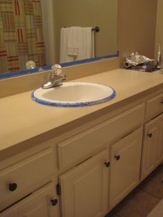 how to paint laminate countertops!  Do I see a kitchen redo in my future??