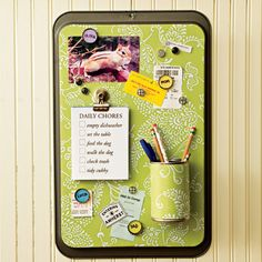 Recycle a cookie sheet into a stylish message center to hang on the wall.