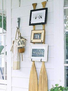 Enlist two retired wooden canoe paddles as the support act for a trio of picture frames. Screw metal hooks into each paddle to create mini ledges for the frames to rest on. For frames in harmony with the backup crew, select ones with scratches and dents. Wooden Canoe, Wooden Paddle, Lake Decor, Coastal Decor, Summer Decoration, Beach Decorations, Rustic Lake Houses, Deco Marine, Mini Loft