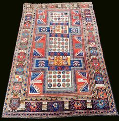 "AH 1321 (1903 ad) dated ""Shield"" Kazak rug"