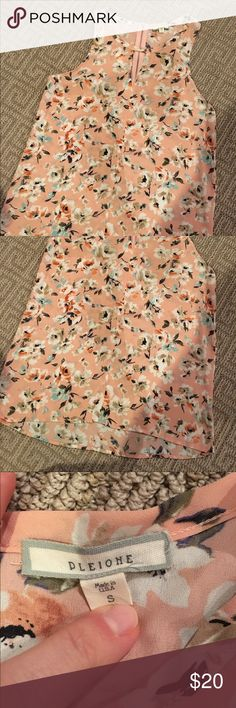 Pale pink floral tunic Size Small pale pink floral tunic with zipper detail. EUC. Pleione Tops Blouses