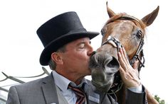 ACAPULCO gets a kiss from trainer Wesley Ward after winning The Queen Mary Stakes at Royal Ascot.