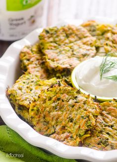 Baked Zucchini Fritters made healthier with whole wheat flour and baked instead of fried. Same crispy zucchini fritters recipe without oil. | ifoodreal.com
