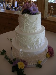Beautiful Mountain themed Wedding Cake by www.coloradorosecakeco.com