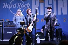 Real Radio's Steve Berry presenting the #HRRisingOnTheRoad competition winners with a brand new Stratocaster - courtesy of Fender! #ThisIsHardRock #Manchester #Guitar