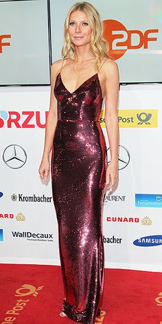 GWYNETH PALTROW Leaving her favorite plunging styles at home, the star dazzles in a fully sequined reddish-pink Prada gown at the Golden Camera Awards in Berlin, Germany.