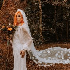 A full length shot of the look. Doesn't the dress and veil look stunning together? We just don't throw these things together you know! video dress leather jacket shoes veil jewellery makeup Celebrant and @ brandon.