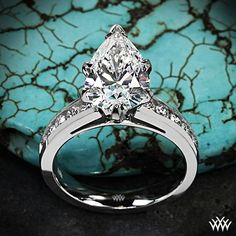 """A pear a day keeps the doctor away! Here we have a glorious 3.00 H VS2 Pear Cut Diamond Semi Custom based off of our 18k White Gold """"Cathedral Channel-Set"""" Diamond Engagement Ring with 10 A CUT ABOVE® Hearts and Arrows Diamond Melee"""