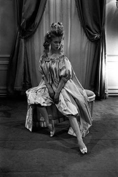 Brigitte Bardot posing for a Christian Dior fashion take, Paris 1960