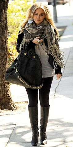 Grey tee, black leggings and jacket, camo scarf,; black oversized leather bag and boots